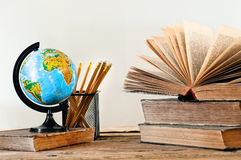 Stack of books with a globe and pencil Royalty Free Stock Photos