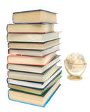 Stack of books and a globe on a white background Royalty Free Stock Photos