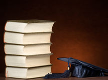 Stack of books and graduation cap Royalty Free Stock Photo