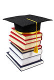 Stack of books with graduation cap. Isolated on white background Stock Photography