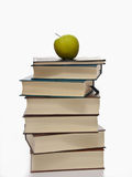 Stack of books with green apple on top Stock Image