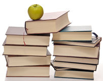 Stack of books with green apple on top Stock Photography
