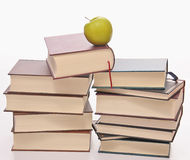 Stack of books with green apple on top Stock Images