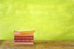Stack of books. Grungy background, free copy space Royalty Free Stock Image