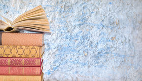 Stack of books, grungy background Stock Image