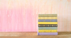 Stack of books on grungy background Stock Images