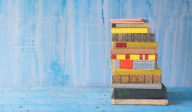 Stack of books on grungy background Stock Photography