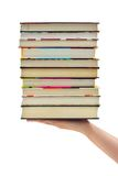 Stack of books in hand Stock Image