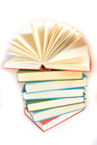Stack of books. Stack of hard-covered multicolored books over white background royalty free stock photo