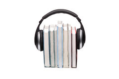 Stack of books and headphones Stock Images