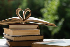 Stack of books with heart shape Royalty Free Stock Photos