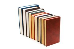 Stack of books isolated. On the white background Royalty Free Stock Photography