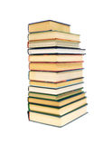 Stack of books isolated on a white background. A large stack of different books isolated on a white background Royalty Free Stock Photo