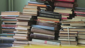 Stack of Books in the Library. A stack of old books in the library is on the floor. Old library books. Full HD 1920 x 1080p, 29,97fps stock footage