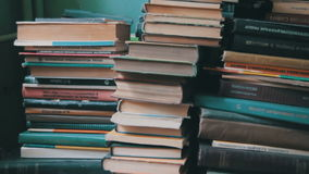 Stack of Books in the Library stock video footage