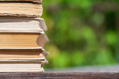Stack of books lies on a wooden table stock images