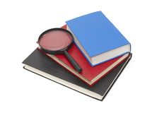 Stack of books and magnifying Royalty Free Stock Image