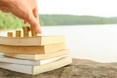 A stack of books with Money growth coins Stock Photography