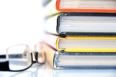 Stack of books. With multicolored covers and glasses Royalty Free Stock Image