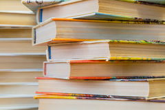 A stack of books in multicolored covers in the library or bookstore stock photos