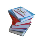 A stack of books, notebook, pencil and glasses Royalty Free Stock Image