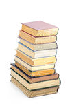 Stack of books. Stack of old books isolated on the light background Stock Images