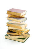 Stack of books. Stack of old books isolated on the light background Stock Photography