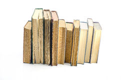 Stack of books. Stack of old books isolated on the light background Royalty Free Stock Photography