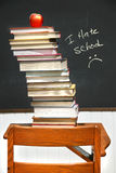 Stack of books on an old school desk Royalty Free Stock Photography