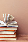 Stack of books. Old books stacked, with one open book on top. Toned image Royalty Free Stock Photography