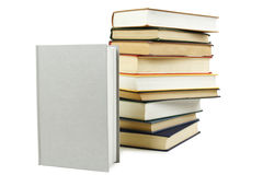 Stack of books and one closed book in front Royalty Free Stock Photography