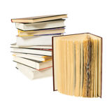 Stack of books. And one open book on white background Stock Photography