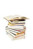 Stack of books. And one open book on white background Stock Photos