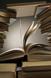 Stack Of Books With One Open Among Them Royalty Free Stock Images