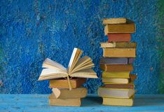 Stack of books, one opened, Stock Photo