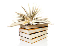 Stack of books with open book. Over white background Royalty Free Stock Photo