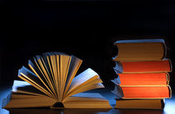 Stack books, open book and copyspace. Royalty Free Stock Photo