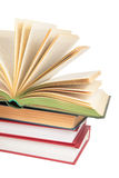 Stack of books with opened book 2 Royalty Free Stock Photos