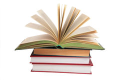 Stack of books with opened book. On white Royalty Free Stock Photo