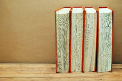 Stack of books in the orange cover Stock Photo