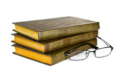 Stack of books with a pair of eyeglasses . Stock Image