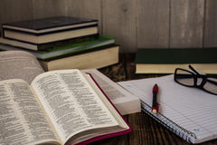 Stack of books, pecil, notebook, glasses, study Stock Photos
