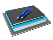 Stack of books with pen Royalty Free Stock Photo