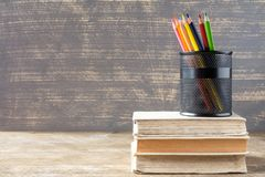 Stack of books with pencil cup Royalty Free Stock Photography