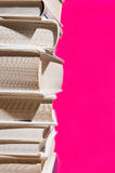 Stack of books on pink. Stack of hardcover books against a vivid pink background. Space for text Stock Photography
