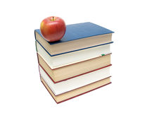 Stack of books and red apple isolated on white background Royalty Free Stock Images