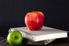 Stack of books and red apple still life Stock Photography