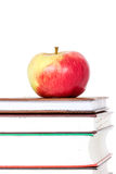 Stack of books with red apple on top Royalty Free Stock Images