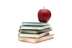 Stack of books and red apple on a white background Royalty Free Stock Image