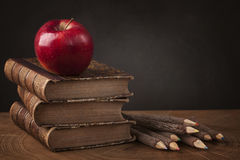 Stack of books and red apple royalty free stock photo